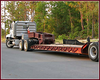 Flatbed Truck Driving on the Road